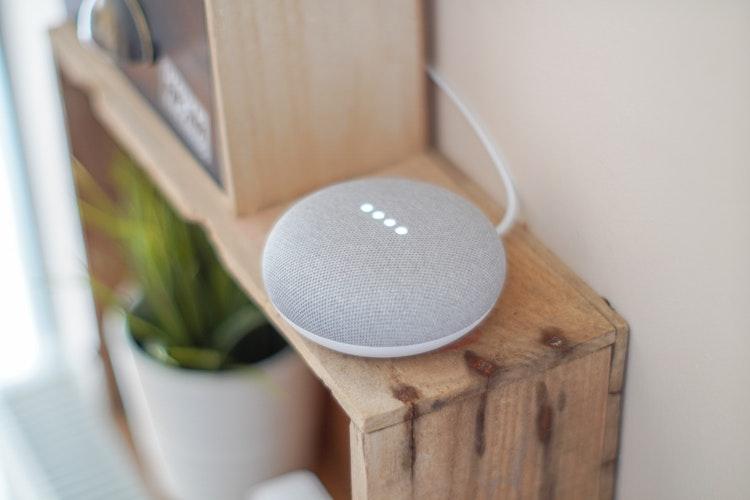 round-grey-speaker-on-brown-board-John-Tekeridis